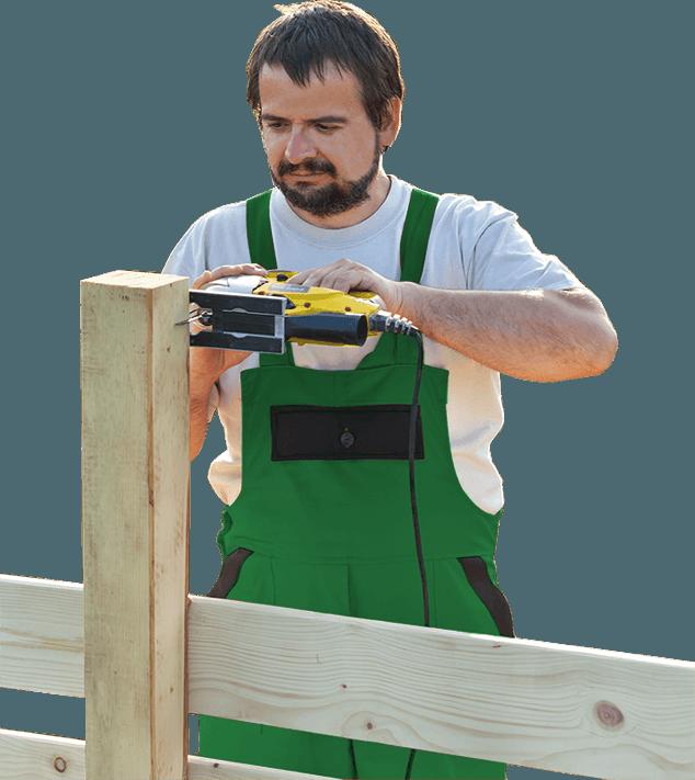 Man Buiding Fence